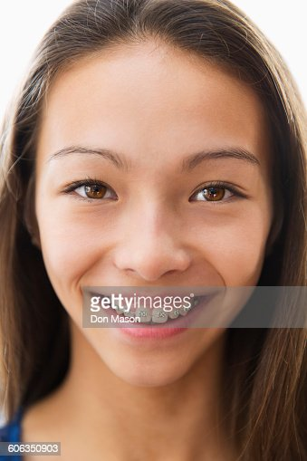 Mixed race girl smiling with braces
