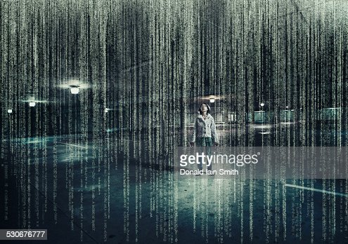 Mixed race girl standing in parking lot under raining binary code