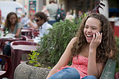 Mixed race girl talking on cell phone outdoors