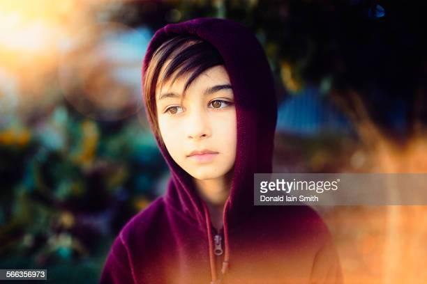 Mixed race girl wearing hoodie outdoors