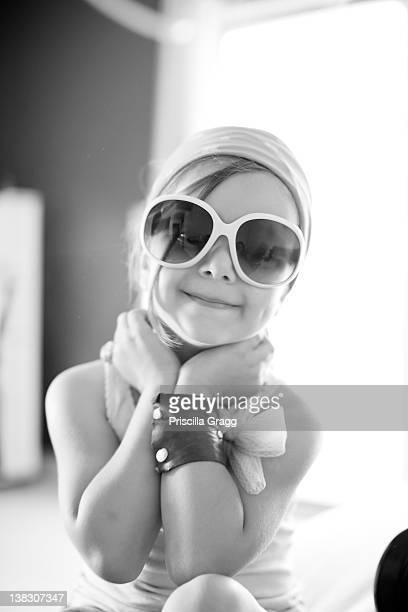 Mixed race girl wearing sunglasses