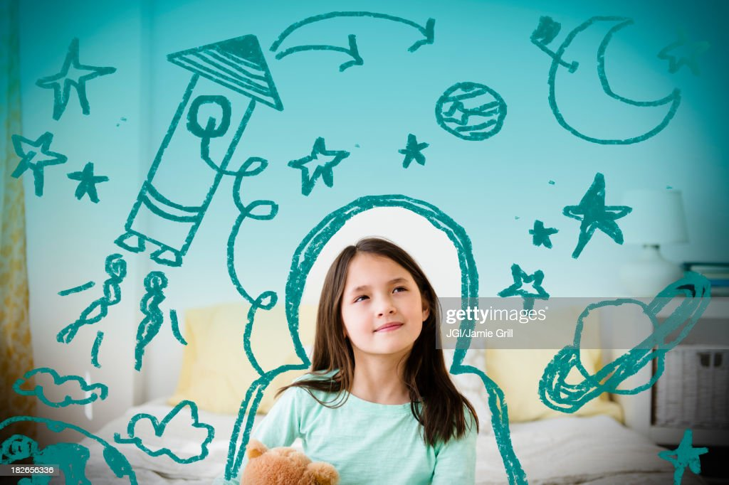 Mixed race girl with space doodles surrounding head : Stock Photo