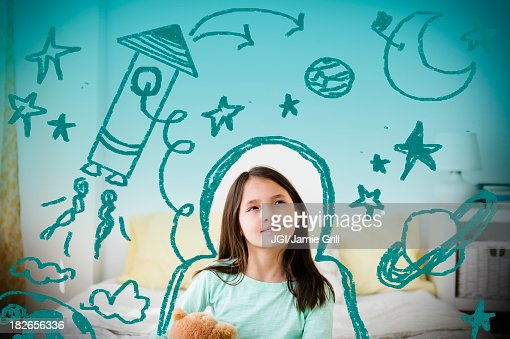 Mixed race girl with space doodles surrounding head