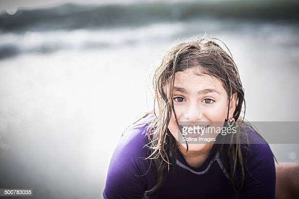 Mixed race girl with wet hair at beach