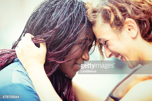 Mixed race girlfriends enjoying to stay together