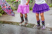 Mixed race girls playing in puddles