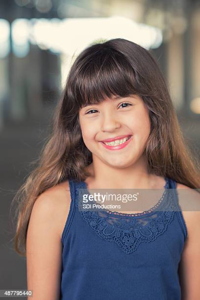 Mixed race Hispanic and Caucasian little girl smiling outdoors