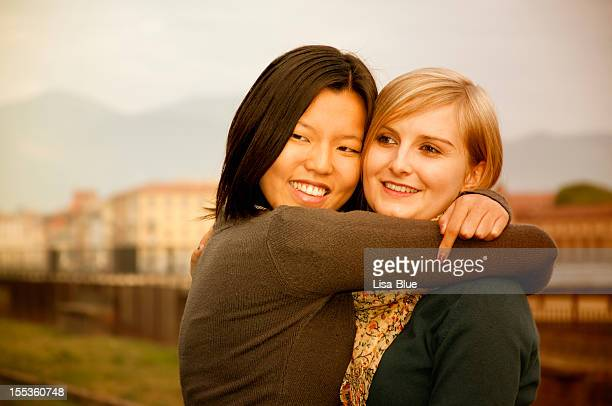 Mixed Race Lesbian Couple Embracing