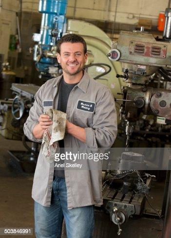 Mixed race machinist working in garage