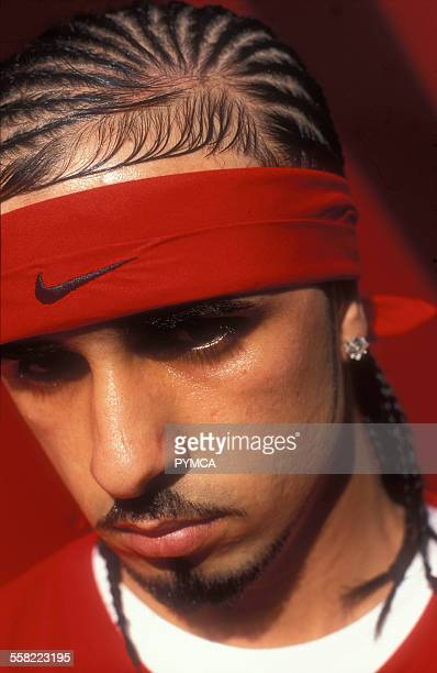 Mixed race male in red Nike headband and red tshirt London 2004