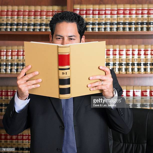 Mixed Race male lawyer reading
