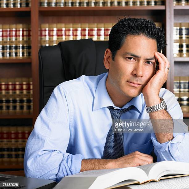 Mixed Race male lawyer with open book