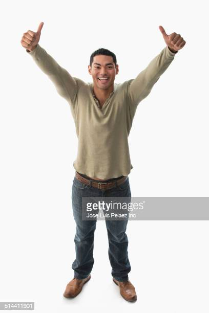 Mixed race man giving thumbs-up