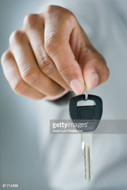 Mixed Race man holding car key