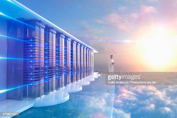 Mixed race man in server room in clouds