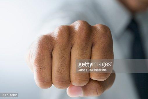Mixed Race man making fist