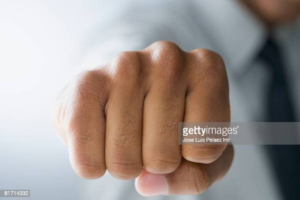 Mixed Race man making fist