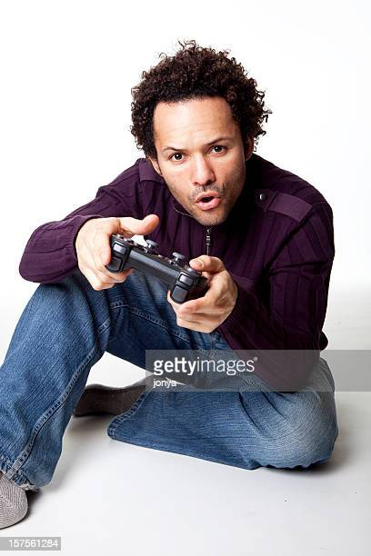 mixed race man playing video game
