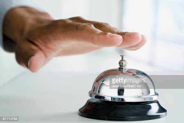 Mixed Race man ringing service bell
