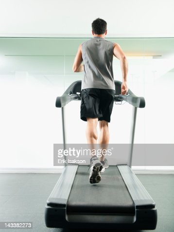 Mixed race man running on treadmill