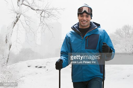 Mixed race man skiing in snow