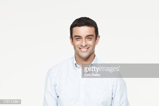 Mixed race man smiling.