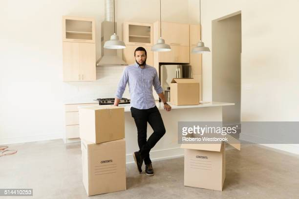 Mixed race man standing in new house