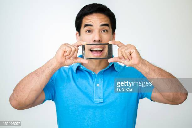 Mixed race man taking digital picture