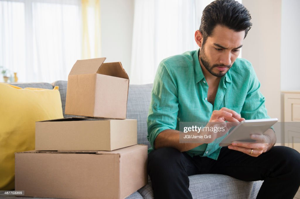 Mixed race man using digital tablet and moving