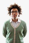 Mixed Race man wearing cardigan sweater