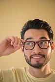 Mixed race man wearing glasses