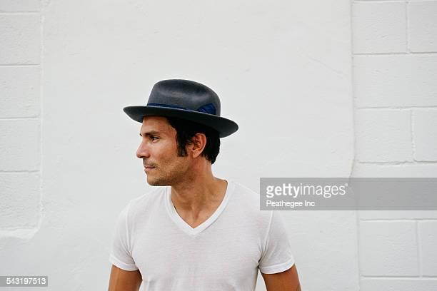 Mixed race man wearing hat outdoors