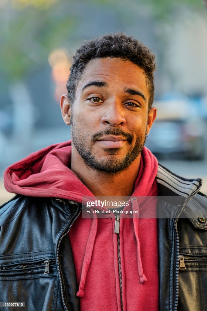 Mixed race man with raised eyebrow standing outdoors