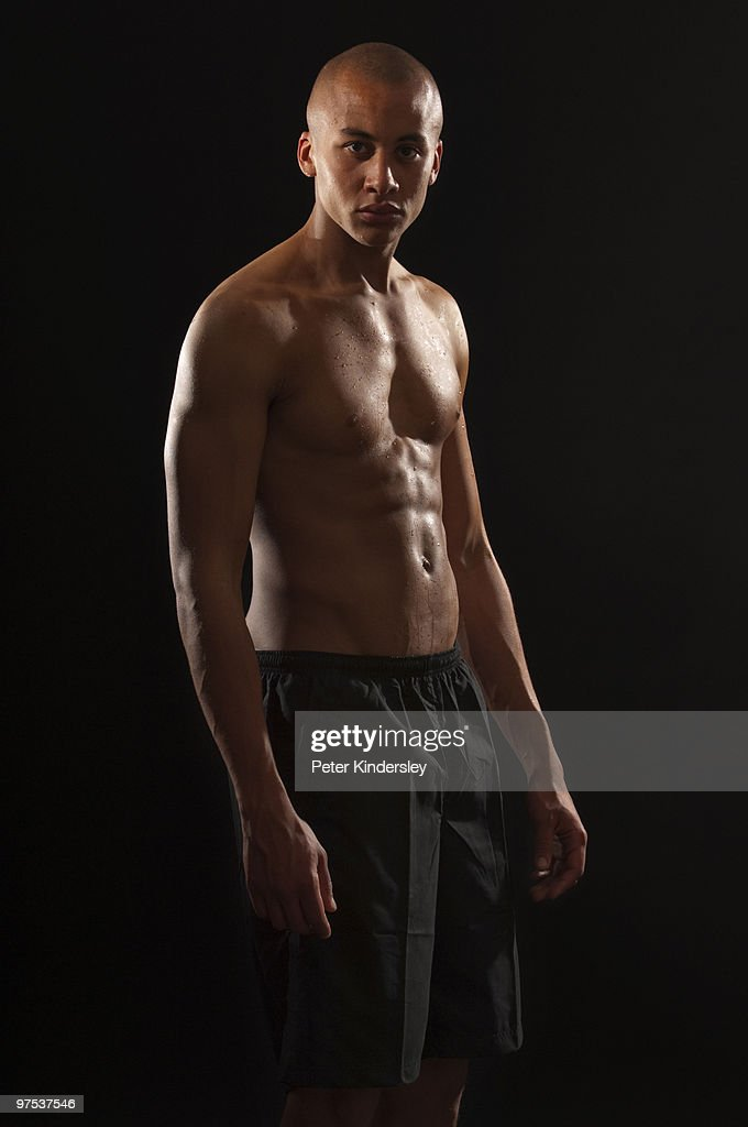 Mixed race man with toned body : Stock Photo