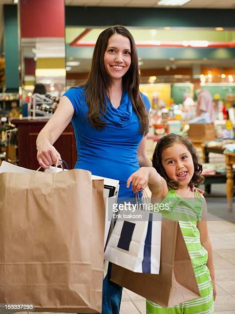 Mixed race mother and daughter shopping together