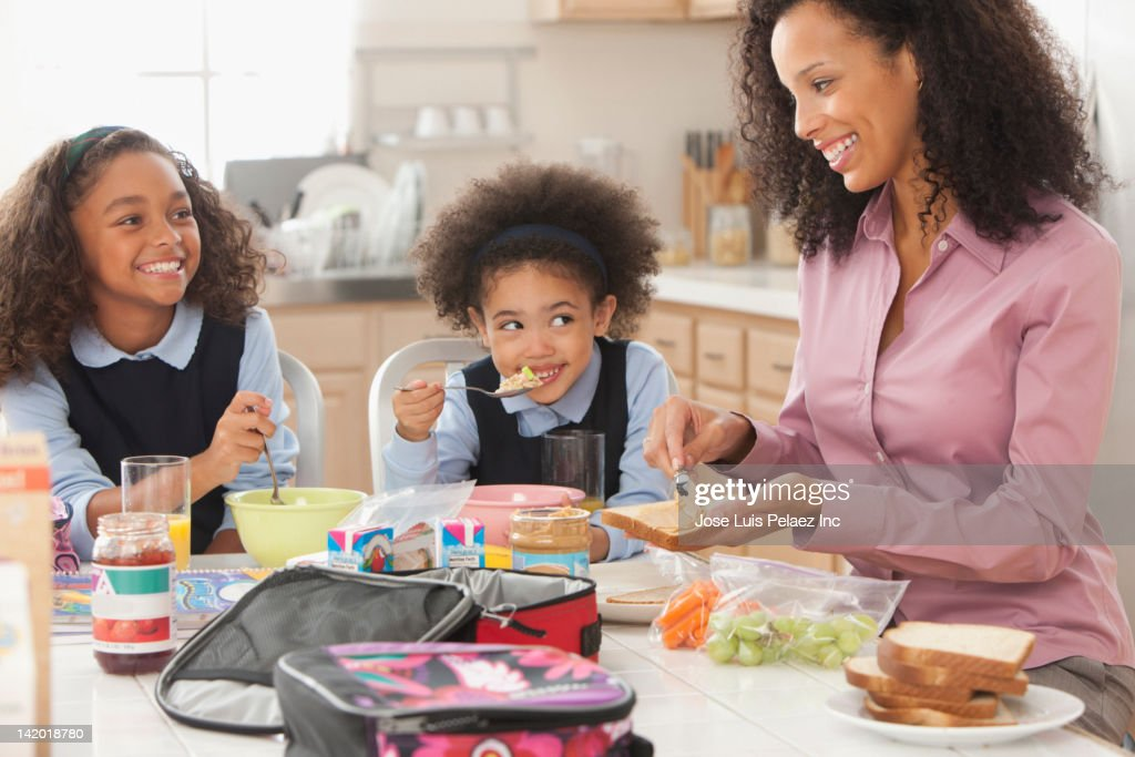 Mixed race mother preparing daughter's lunch