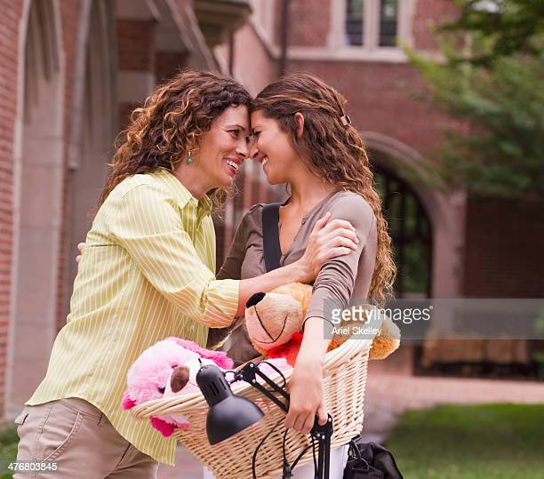 Mixed race mother saying goodbye to daughter going to college