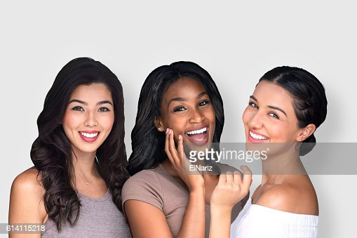 Mixed race multi-ethnic female friends laughing together perfect smile : Stock-Foto