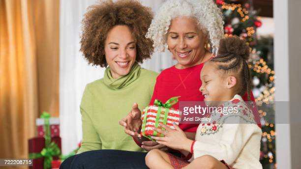 Mixed Race multi-generation family giving gift on Christmas