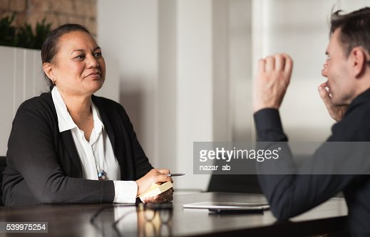 Mixed Race People in Meeting : Stock Photo