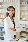 Mixed race pharmacist standing at counter