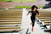 Mixed race runner training in stadium