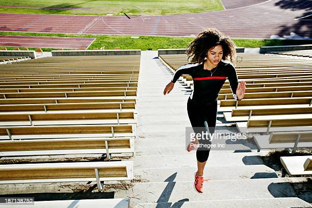 Mixed race runner training in stadium