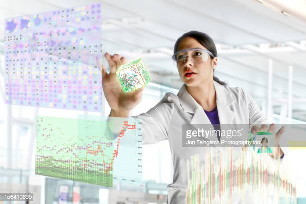 Mixed race scientist working with scientific images