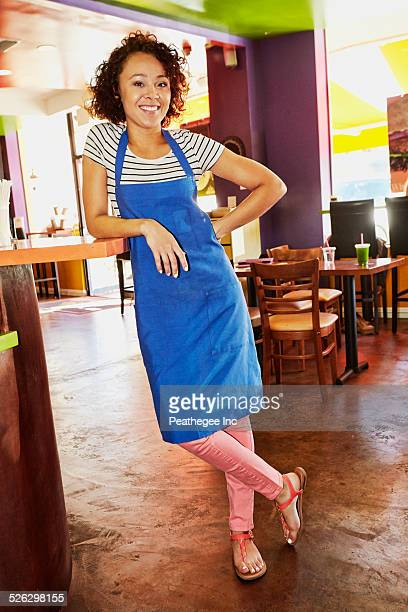 Mixed race server smiling in cafe
