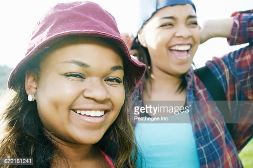 Mixed Race sisters laughing outdoors