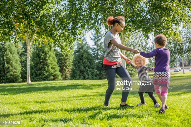Mixed race sisters playing outdoors
