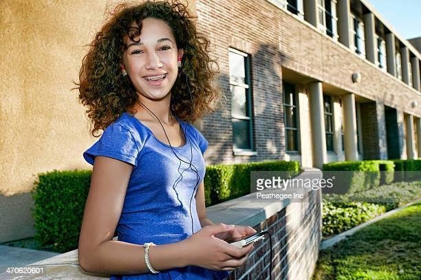 Mixed race student listening to headphones