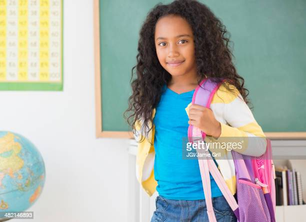 Mixed race student smiling in classroom
