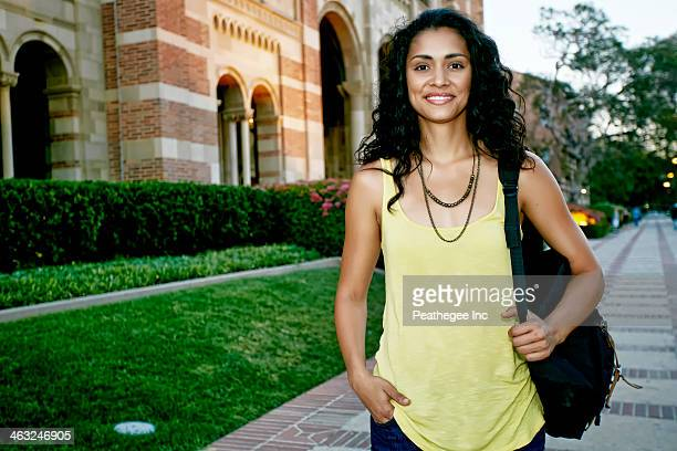 Mixed race student smiling on campus